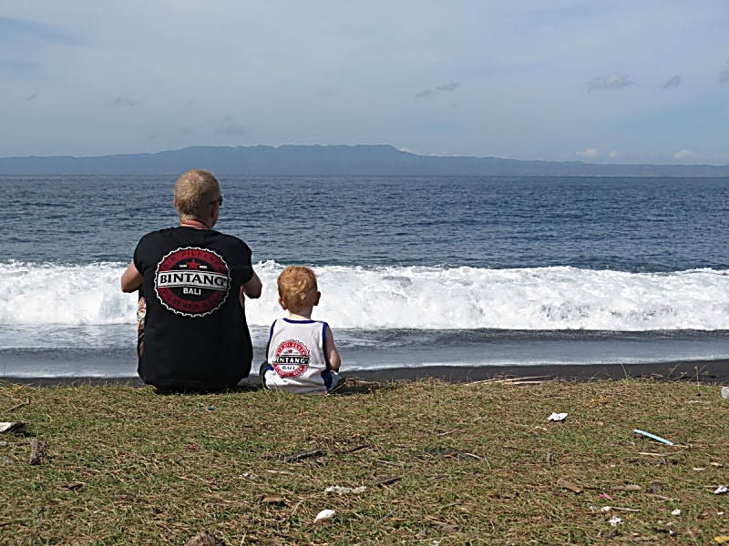 Father and son by the beach of Bali